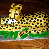 Cheetah Cake This is a cake I made for a girl;s birthday. Chocolate cake and chocolate filling. Wrapped in MMF. Way too many spots!