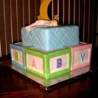 "Sleeping Baby Shower Cake  This is a cake I made for a Baby Boy's Baby Shower. The cake is Marble. 8"" and 12"" Square. Covered in MMF. The baby is..."
