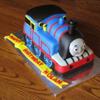 Thomas The Train I made this for a friend's son's birthday. Marble cake covered in BC then MMF.