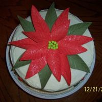 Christmas Poinsettia This is a gum paste Poinsettia. I couldn't find any instructions to make one so I came up with it myself. This cake is a red velvet...