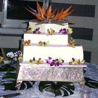 White Chocolate Wedding Cake With Birds Of Paradise And Orchids