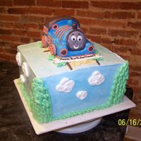 Thomas The Train Red velvet cake covered and layered with white chocolate imbc. Thomas is carved cake covered in fondant.