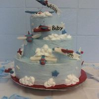Airplanes The cake is chocolate with whipped icing. The decorations are made out of fondant. The airplanes were made a little too big but none the...