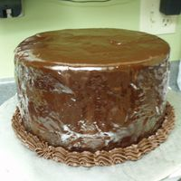 First Ganache Poured Cake...  Okay, not so happy with how this turned out. :( But I know my co-workers will like it. :) This is the chocolate stout cake recipe with...