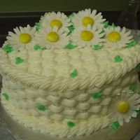 Basketweave With Daisies  This is a chocolate cake with ganache filling, BCD icing and gum paste daisies. Brought this cake to my Bunko group and it was a hit. :)...