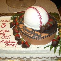 Baseball Retirement Cake This cake was for a retiree at work. The bottom was a white cake, the glove and ball were chocolate.