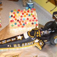 "Us Army Dragster ""the Sarge"" My intention was for a smaller cake, well, it ended up being roughly 30"". The car is made from a loaf pan and is a creme bulee butter..."