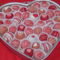 Valentine's Day Cake Balls A variety of cake balls to try out some different flavors. The white is chocolate amaretto, the red is raspberry almond, the light pink is...