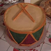 Christmas Drum Round cakes covered in BC. Gold accents are fondant painted with luster dust.