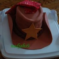 Cowboy Hat I had trouble with the fondant (I just can't seem to get the hang of it!) so I had to come up with creative ways to cover up the...