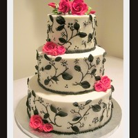 "Black, White & Red Birthday Cake  From the Confetti Cakes book. 12"", 9"", 6"" BC with fondant leaves. RI red roses on the sides, roses on top were from GSA,..."