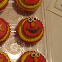 Elmo Cupcakes BC swirl on top. Elmos are modeling chocolate; much tastier than fondant! Mouth is drawn with edible marker.