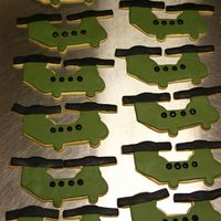 Chinook Ch47 Helicopter Cookies My husband is in flight school so I made these for the family day. This is the first time ever making fondant covered cookies and it took...
