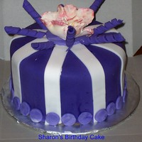 Birthday Cake Lemon Cake, Purple and White Fondant, White Bow did not survive, had to substiute with gumpaste flower!