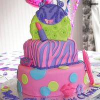 Glamour Girl 9Th Birthday  I made this cake for my daughter's 9th birthday. WASC cake with vanilla buttercream and MM fondant. It was my first time for all three...