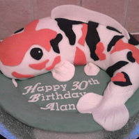 Koi Carp made this from a customers drawing, the cake is chocolate truffle, covered with fondant and sitting on a pastilage plate which may i add...
