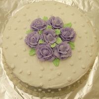 Wilton Course 1 Final Cake Butter Vanilla cake with buttercream frosting and purple roses on top. This was my course 1 final cake for Wilton classes.