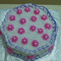 Pretty Cake Marble cake with color stripping border and drop flowers. All done in buttercream icing