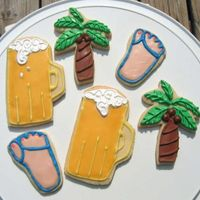Summer Wilton's rolled cookie recipe. Palm trees are royal icing, flip flops and beer mug are powdered candy fondant icing. Need work on the...
