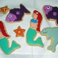 Mermaid, Dolphin, Fish No Fails with Wilton's Pour Cookie Icing. Couldn't figure out the mermaid cutter but in the end, I'm pretty happy with it....