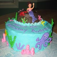 Under The Sea Cake was for my daughter's 5th birthday party. Buttercream with royal icing decorations. The coral was inspired by tabs8774 design....