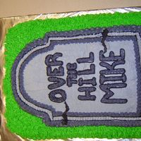Over The Hill Cake Cake is decorated with 100% buttercream...