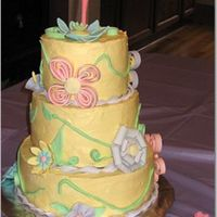 Spring Birthday Cake This is the cake for my daugther's first birthday. It was frosted in buttercream and had gumpaste and fondant accents.