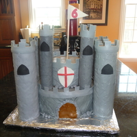 Colin's Castle My first castle cake! For my son's 6th birthday. I used 10-inch and 6-inch pans. Covered in MMF. I spent a lot of time looking at...