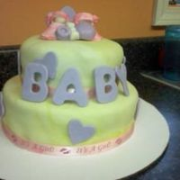 Baby Shower Baby Shower cake for a friend, wanted yellow, purple and pink as colors.