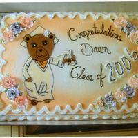 Graduation Bear   The bear was drawn free-hand and my homemade buttercream icing was colored, melted down and piped into the photo.