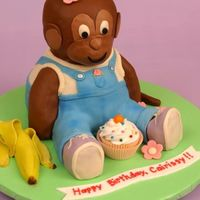 Chocolate Monkey Cake Basic Chocolate Fudge Pound Cake, chocolate icing and covered in modeling chocolate. The pink flowers and banana are fondant. For in-...