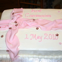 Pink First Communion Italian Cream cake with crusting cream cheese frosting. Fondant ribbon and flowers.