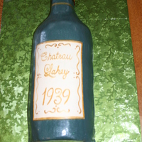 "Wine Bottle White cake with buttercreamm icing. Used the birthday boys' name in the name of the wine and it was ""bottled"" the year he..."