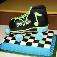 Rockand Roller Skate Skate is white cake covered with fondant. Floor is chocolate cake with buttercream sides, fondant checkerboard. Wheels were made of fondant...