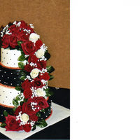Black, White, And Red Wedding My best friend's wedding cake. BC frosting with real flowers, baby's breath and leaves.