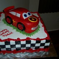 3-D Lightning Mcqueen Close Up  This is the second of two cakes I did for my son's 4th b-day. I was amazed at how easy it was to do the car; thanks to Nati for the...
