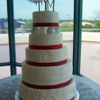Red And White Wedding Alternating tiers of white almond sour cream and red velvet cakes.