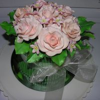 Dscn0711.jpg   Gumpaste roses and filler flowers create a bouquet cake.