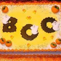 Just A Fun Halloween Cake... Buttercream with color flow letters and ghosts and fondant pumpkins..