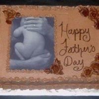 Father's Day Cake... Chocolate Buttercream with buttercream roses and edible image.