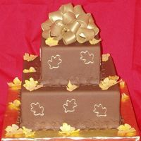 Chocolate Fondant With Gumpaste Bow And Fall Leaves I did this cake awhile ago...It was chocolate fondant, gumpaste leaves and bow. I don't know what I was thinking with the red...