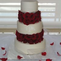 Trisha And Alex's Wedding Cake   WASC with strawberry and blueberry filling, covered in MMF with royal icing monogram and fresh roses