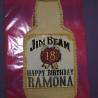 Jim Beam Cake two layers of coca-cola cake filled with jim beam bourbon whiskey vanilla mousse, iced in cola-flavored buttercream. label and cap are made...
