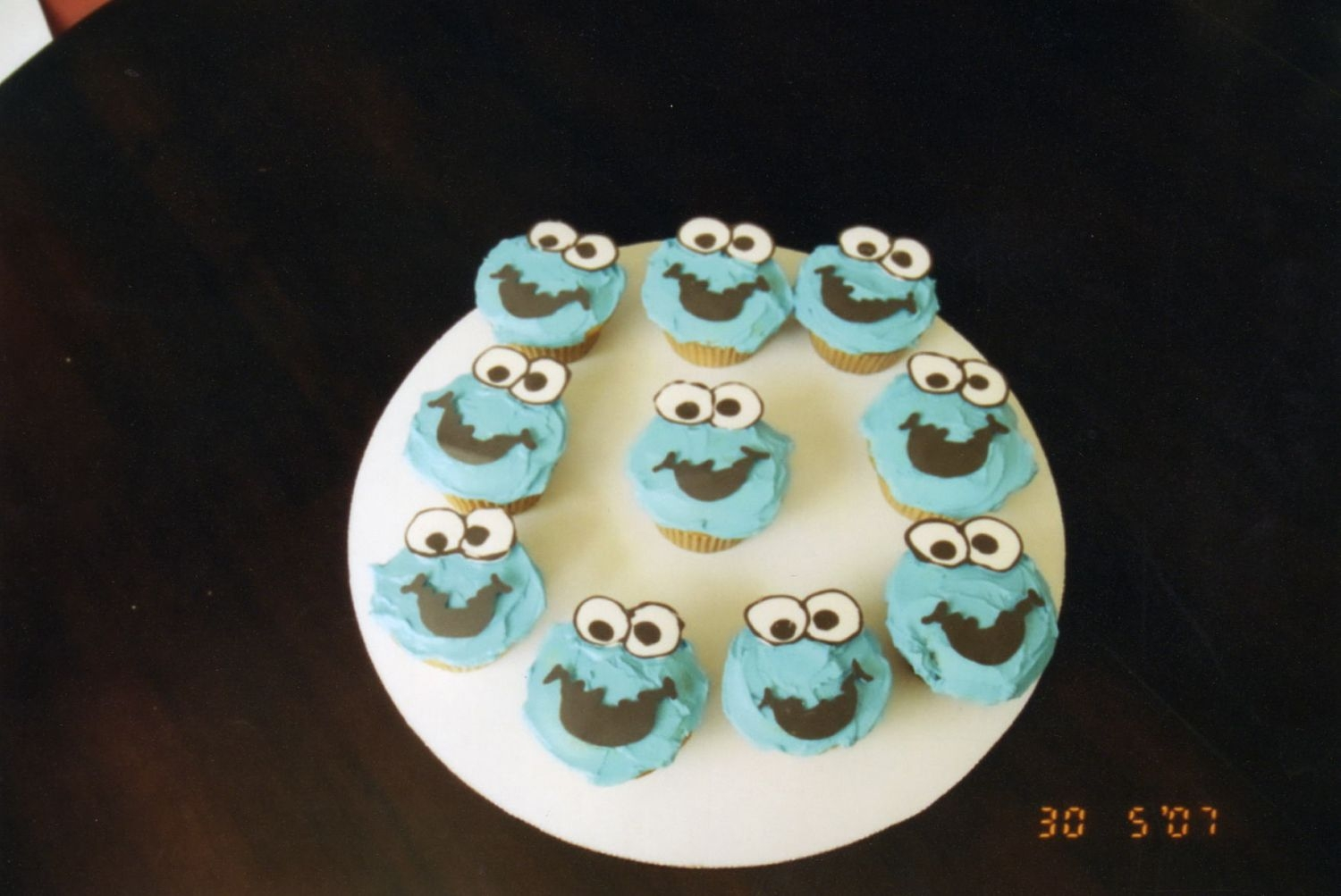 Cookie Monster Cupcakes I made them to go with the sesame street cake I made for my boy's 1st bday. The eyes and mouth are chocolate.