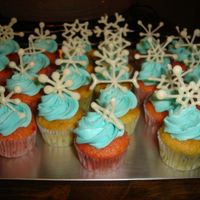 Mini Snowflake Cupcakes   Strawberry and vanilla mini cupcakes w/buttercream and white chocolate snowflakes.