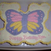 Butterfly Cupcake Cake   1/2 German choc cupcakes w/oreo filling and 1/2 funfetti cupcakes w/vanilla pudding filling. Covered in buttercream w/butterfly.