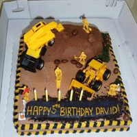 Construction Worker Cake All Buttercream icing, top mound of dirt is chocolate buttercream, sheet is regular buttercream just colored brown to give the guests a...