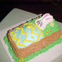 Easter Baby Shower Cake   This is a shower cake for a baby due on Easter. Everything is buttercream.