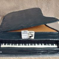Grand Piano WASC cake covered in BC and fondant. Piano top is cardboard covered in fondant, supported with straws. Keys are a strip of fondant and hand...