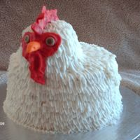 White Rooster Ii WASC cake with raspberry filling, covered in BC with fondant face. This one is better than my first attempt, on which the head ended up...